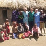 Volunteers Taking a Group photo with Tanzanians.