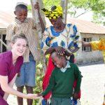 Volunteer Receiving A High Five in Tanzania