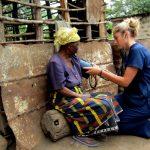 Tanzanian Volunteer Takes Blood Pressure
