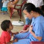Nursing Volunteer Shares Her Heartbeat with A child