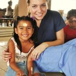 Panama Global Health Volunteer With A Child In Panama