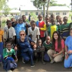 Volunteers Taking a Photo with Tanzanian Children
