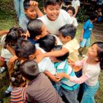 Nicaraguan Children Having a Group Hug