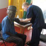 Volunteer Taking Blood Pressure of Jamaican Man