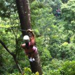Volunteers Zip-lining Across the Rainforest
