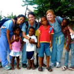 Group of Volunteers with Jamaican Children