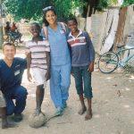 Volunteers Play Soccer with Jamaican Children