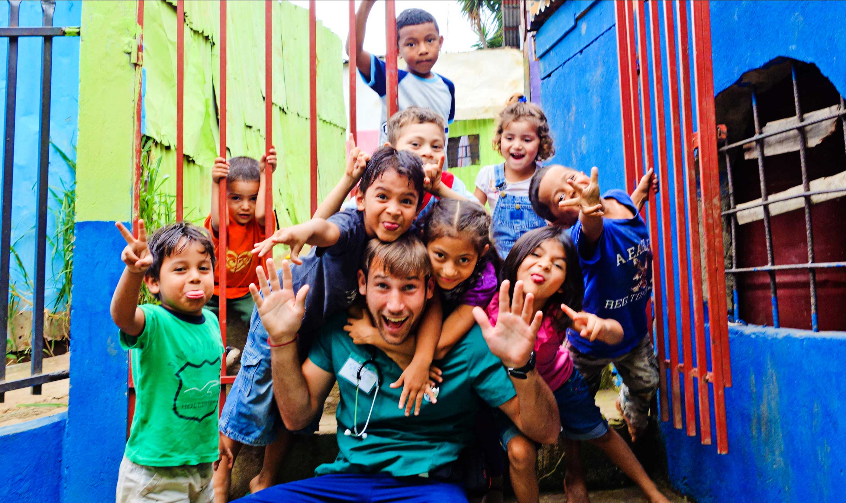 Volunteer Taking A Photo With Children