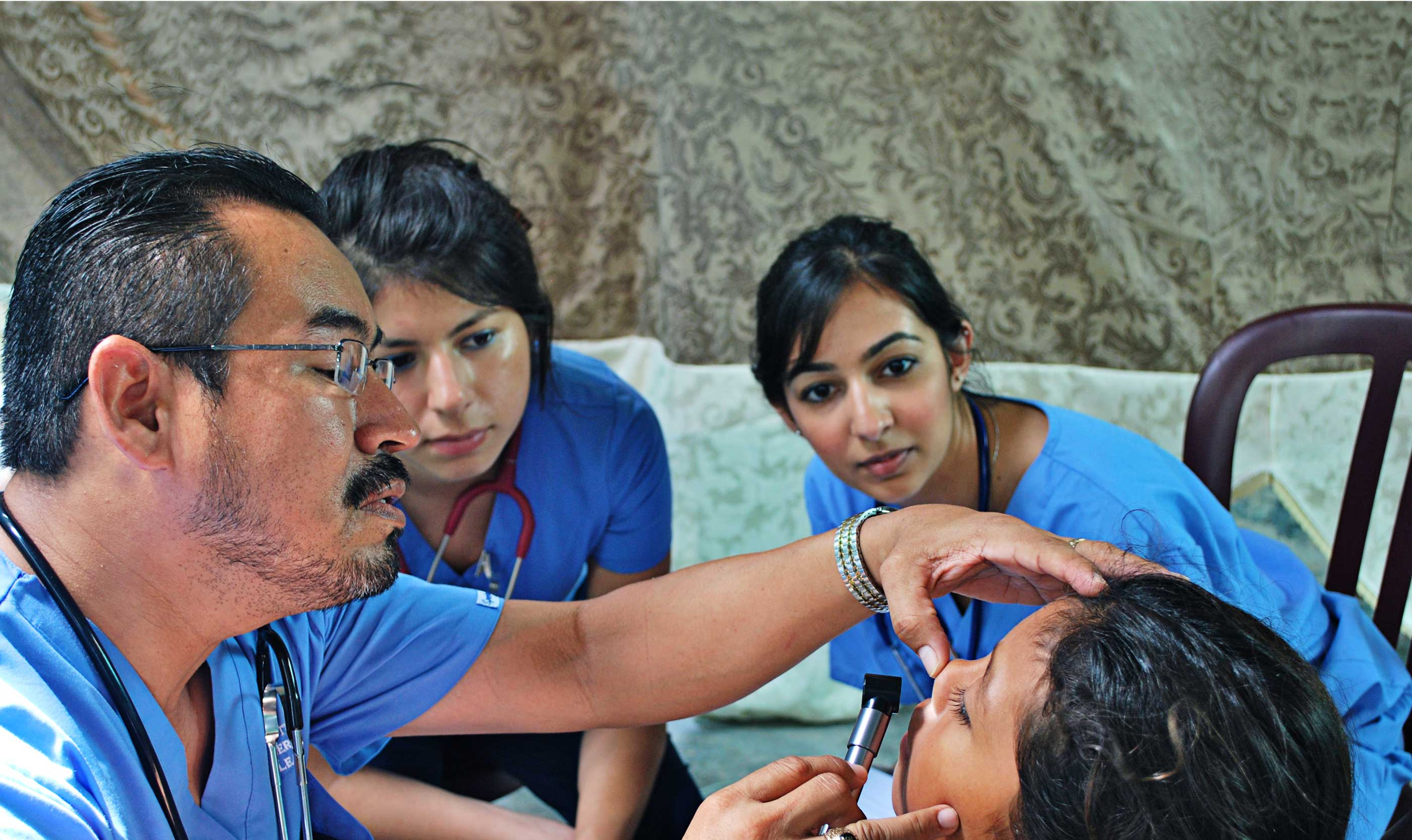 Volunteers Observe a Physical Exam