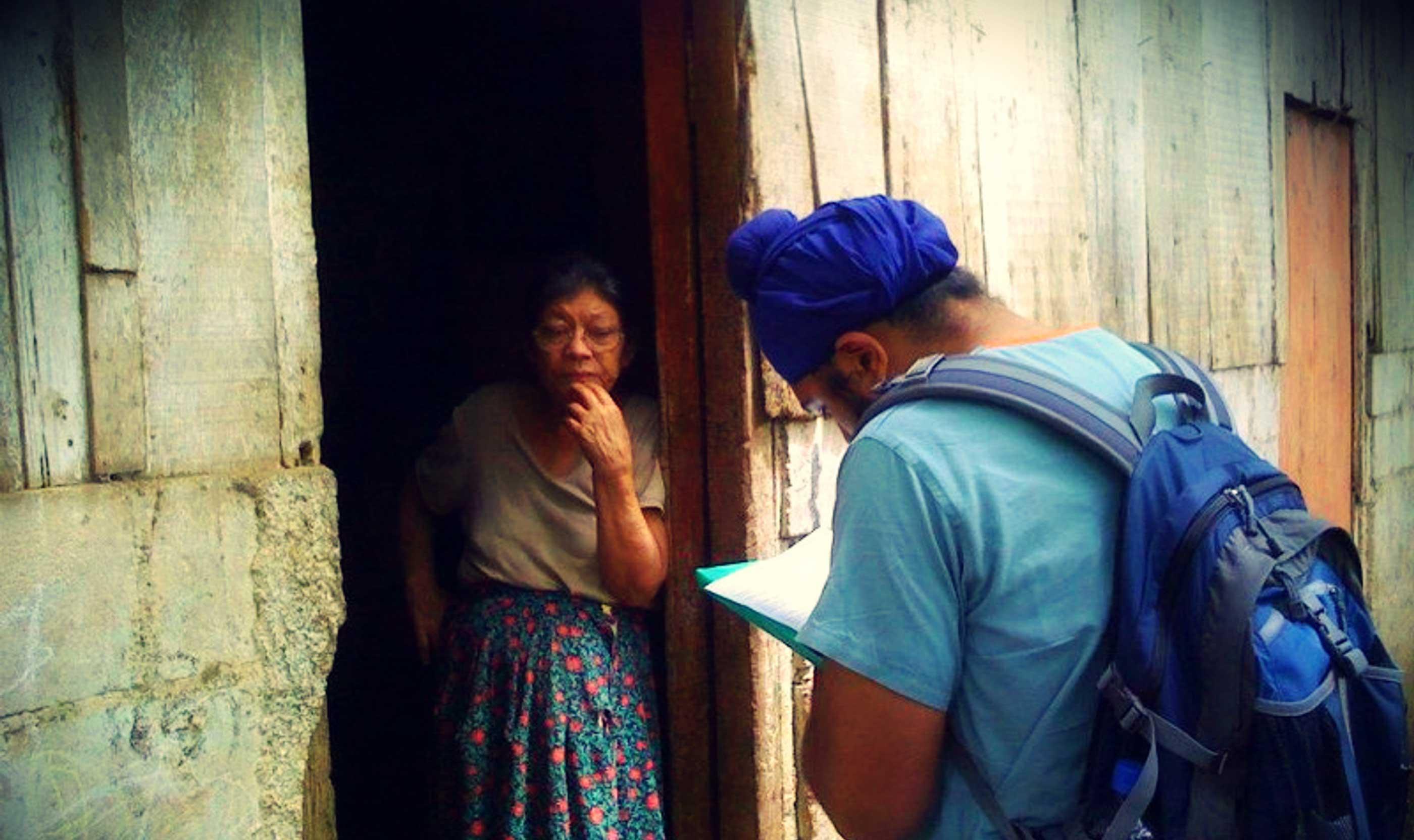 Volunteer in Nicaragua Preforming A Home Visit