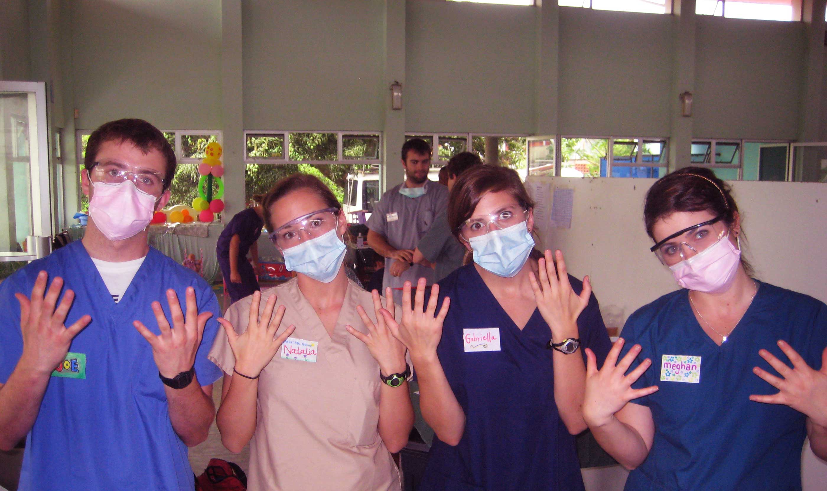 Volunteers Wearing a Mask in A Clinic Setting