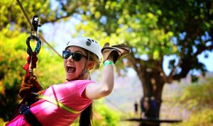 An ISL volunteer enjoying a zip line.